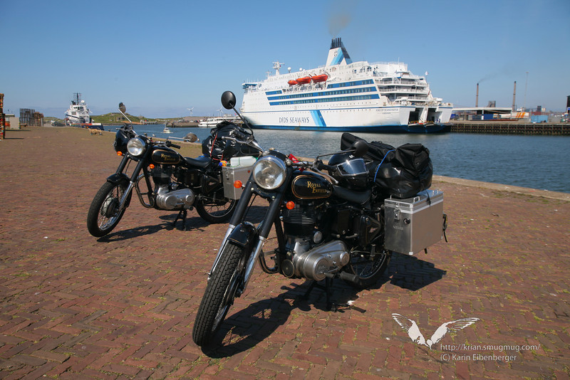 Our first motorcycle journey! Wow! Leaving the harbour in Amsterdam on our two 500 cc Enfields.