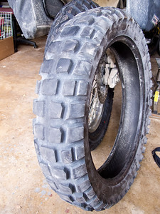 Kenda K784 Big Block rear tire at 880 miles.