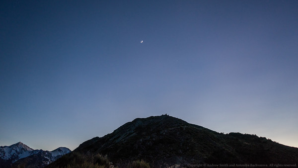 A sickle moon and Venus in first light above Mt Fyffe.