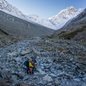 We walk further up the creek to get a different angle on the gullies between the cliffs.