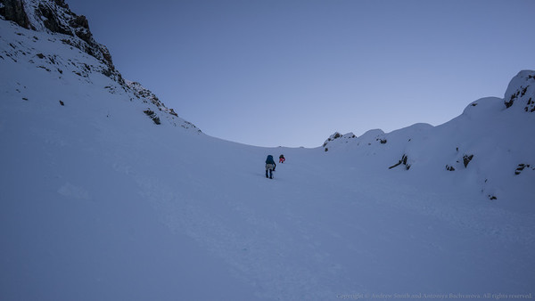 Max leads up the steep snow slope to White Col.