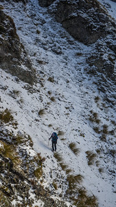 Crossing a steep scree slope as we sidle back to the saddle.