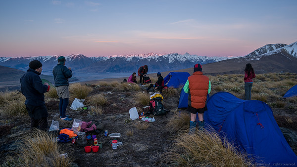 We eat breakfast at our superb camp site as the first rays of sun hit the Two Thumb Range.