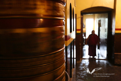 A monk and a spinning prayer wheel in the Swayambhunath temple in Kathmandu.