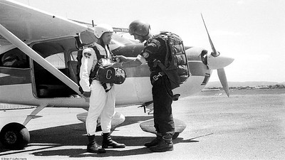 QPC Archerfield  1962.  Sully is jump master on the Cessna 182 to Redbank Plains. A DZ party would have already driven out there to put out the cross and arrow for wind.