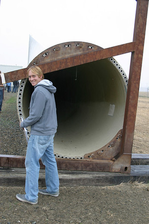 Mark Sherwood, up close and personal with the back and of a 125 foot wind turbine blade.