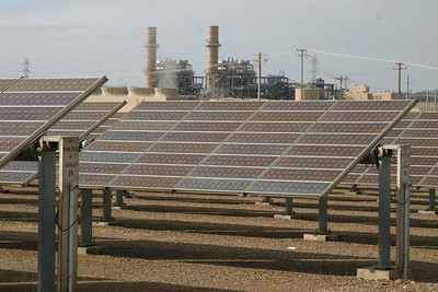 Solar arrays with a 500 mW natural gas cogeneration plant behind.