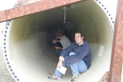 Joe Westersund seeks shelter from the rain inside the turbine blade.