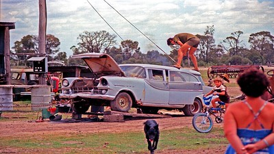 Oxy cutter on the Holden roof to make a man hole for hunting. Note thongs on operator. Could be painful. Standard Vanguard car wagon at left by the MF tractor. Paul Harris & Barbara Harris. Goombi.