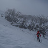 We reach the boundry of the ski field. The wind is howling over the top so we stay low.