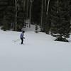 Sarah gliding through the snow.