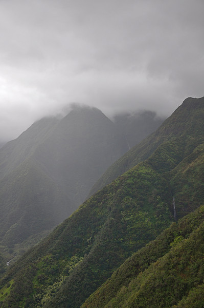 The mountains of the Waihee Valley were covered in clouds and it was raining off and on, not the greatest hiking day.  From the trail, the huge Makamakaole Falls and sunken valley could be seen in the distance.