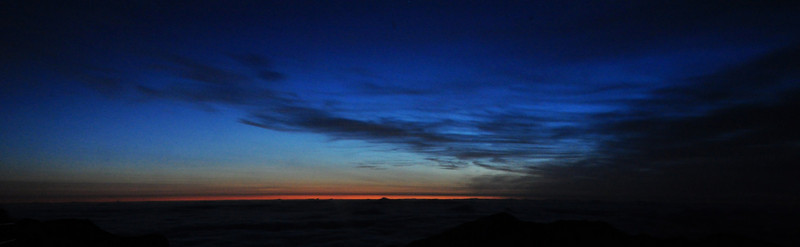 at 4:45 am the sun started to creep above the clouds atop Haleakala