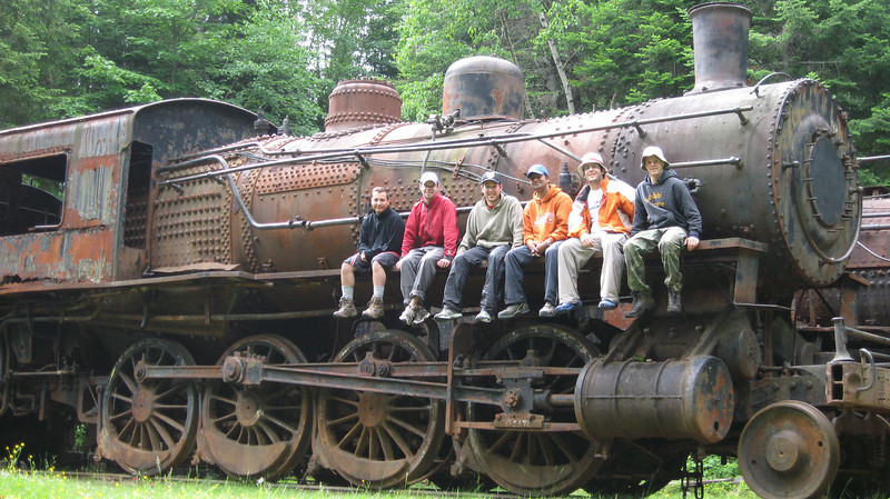 The group (Ben Goldberg, Topshelf, Brody, Nik, Cheese, Dave) at the rusted old tram cars