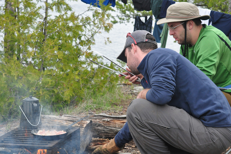 Matt manning the fire, with the ever watchful cook standing guard