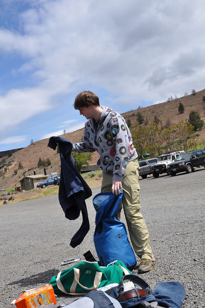 Ryan making sure all his long sleeve cotton shirts are secure in the dry bag.