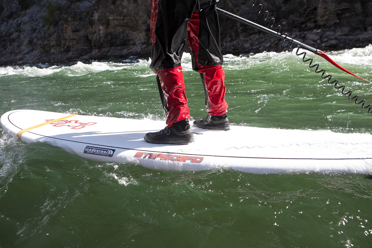 A man paddle boards through rapids on the Snake River near Jackson Hole, Wyoming