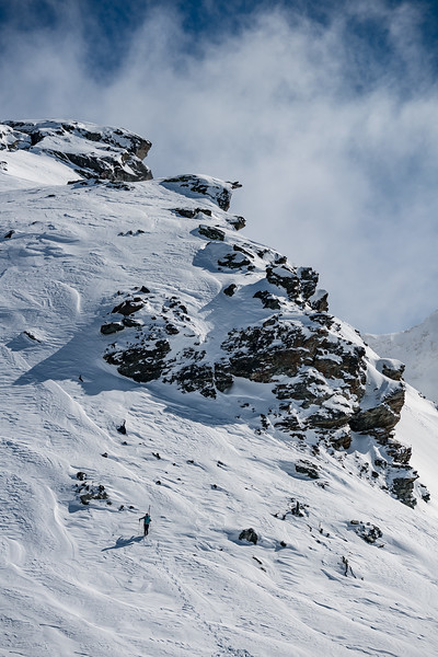 After scoping a line during a break in the fog Gabriella Edebo hikes her way in the Nendaz backcountry to her goal.