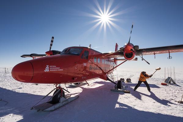 Mike Bertrand dislodging frozen skis, Theils Depot, 85º, Antarctica