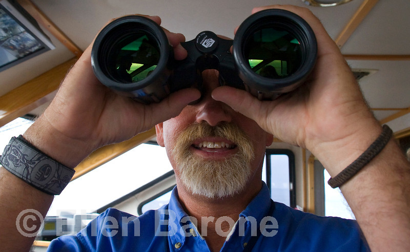 Captain Rod DuFour searches for marine life from Safari Quests' wheelhouse, Sea of Cortez, Baja California Sur, Mexico.