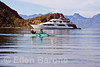 American Safari Cruises' luxury yacht, Safari Quest, at anchor while passengers enjoy a morning kayak  in Balandra Bay off Isla del Carmen, Sea of Cortez, Baja California Sur, Mexico.