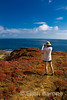 Photographing the view at Punta Pitt, Isla San Christobal, Galapagos Islands, Ecuador.