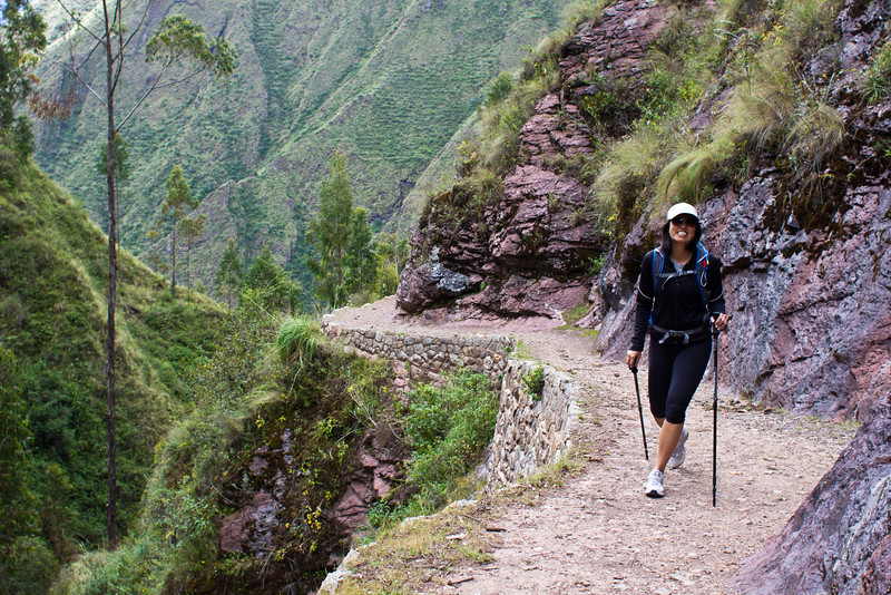 A B&R walker hikes among ancient Inca terracing near Chinchero in the Sacred Valley of Peru, South America.