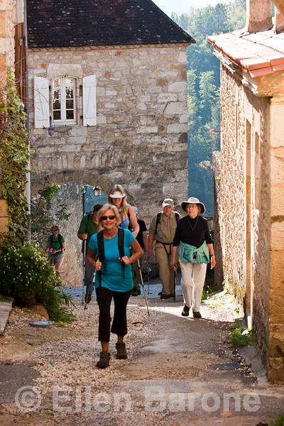 Wayfarers, entering Castlenaud, Dordogne, France.