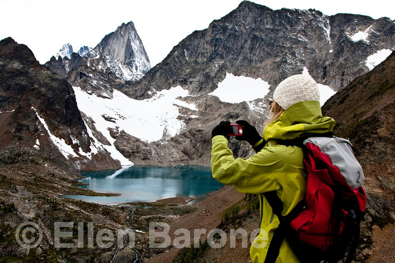 Hiker taking photograph, Heli-hiking vacation, Canadian Mountain Holidays, Canada.