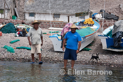 Members of the Cuevas family greet Safari Quest skiff at Isla Coyote (Pardito), a small fishing island home to the Cuevas family for almost one hundred years, Sea of Cortez, Baja California, Mexico.