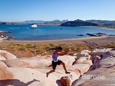 Safari Quest passenger Jordon Mauro enjoying the scenic red sandstone at Puerto Los Gatos, Sea of Cortez, Baja California, Mexico.