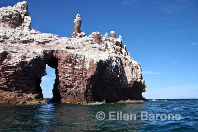 The guano coated sea cliffs at Los Islotes sea lion rookery, Sea of Cortez, Baja California, Mexico.