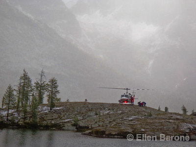 Helicopter, mountain clouds, pocket lake, Heli-hiking vacation, Canadian Mountain Holidays, Canada.,