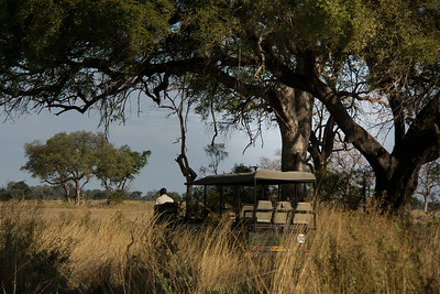 Safari vehicle with spotter, &Beyond Xaranna Okavango Delta Camp, Botswana