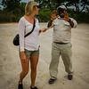 Safari guest and guide saying goodbye, Khwai River airstrip, Moremi Game Reserve, Okavango Delta, Botswana, Africa.
