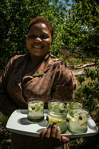 A friendly welcome and drinks at &Beyond Xaranna Okavango Delta Camp, Botswana