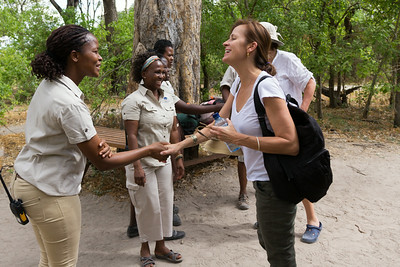 Camp staff welcome guests at Machaba Camp, Okavango Delta, Khwai River region, Botswana, Africa.