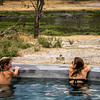 Riverside swimming pool, game viewing, hippo pod, Machaba Camp, Moremi Game Reserve, Okavango Delta, Khwai River region, Botswana, Africa.