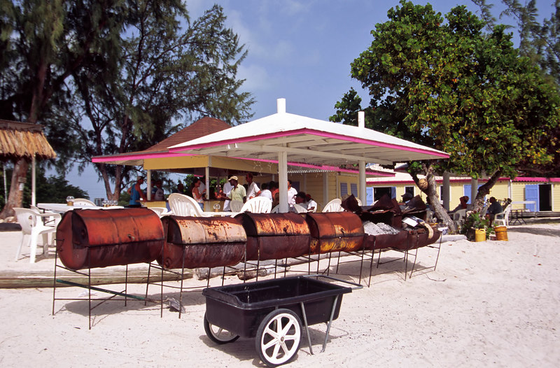 Steel drums are used to grill lobster for the Anegada Reef Hotel's popular lobster b.b.q., the Anchorage, Anegada, British Virgin Islands, West Indies, Caribbean.