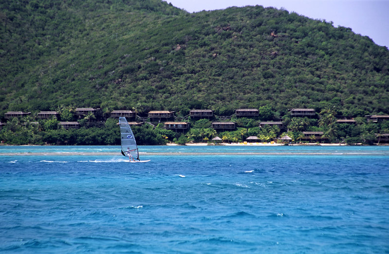 Wind surfer, Eustatia Sound off Prickly Pear island and Virgin Gorda with the Bitter End Yacht Club and Resort in the distance, British Virgin Islands (BVI), West Indies, Caribbean.British Virgin Islands (BVI), West Indies, Caribbean