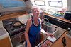 Charter chef Spike Shavers in the galley aboard The Moorings 45-foot catamaran Triple Dog Dare, British Virgin Islands (BVI), West Indies, Caribbean.