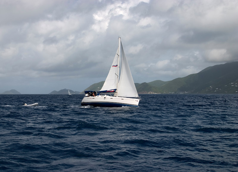 A Moorings 403 charter yacht under sail in Sir Francis Drake Channel, British Virgin Islands (BVI), West Indies, Caribbean.