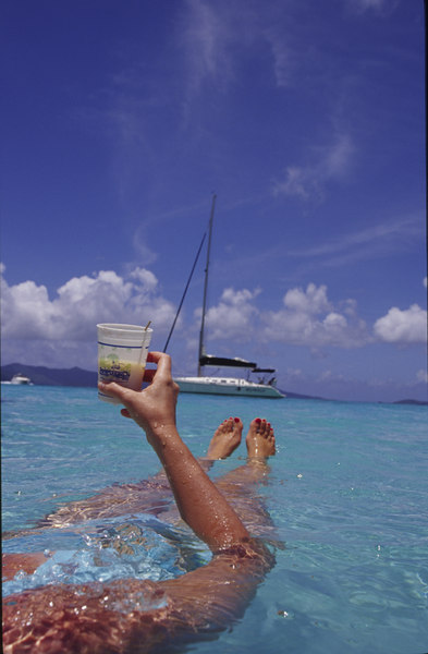 Enjoing a Soggy Dollar Bar painkiller while cooling off in White Bay, Jost Van Dyke, British Virgin Islands, West Indies, Caribbean.