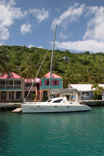 Colorful Soper's Hole, a protected harbor lying between Frenchman's Cay and Tortola, is the port of entry for vessels arriving and departing British Waters, British Virgin Islands (BVI), West Indies, Caribbean.
