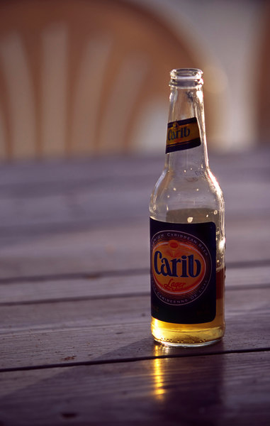 A bottle of Carib beer, beachside bar, Anegada Reef Hotel, Anegada, British Virgin Islands (BVI), West Indies, Caribbean