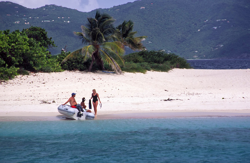 Yachties use their dingy to go ashore on Sandy Cay, an idyllic small islet surrounded by turquoise water, and anchorage gem east of Jost Van DykeBritish Virgin Islands, West Indies, Caribbean.