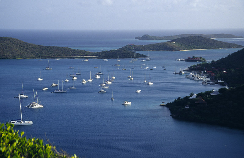 Moored yachts fill the harbor at Biras Creek, Virgin Gorda, British Virgin Islands, West Indies, Caribbean.