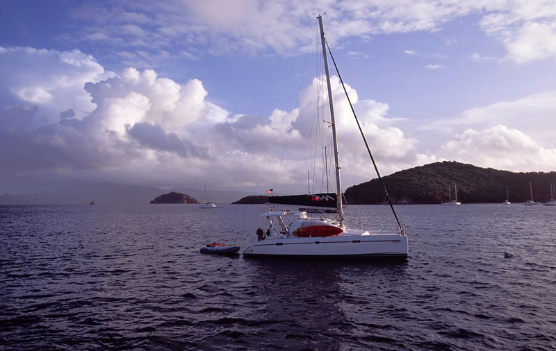 A Moorings catamaran is moored in The Bight, an exceptionally well-sheltered anchorage on Norman Island (often referred to as Treasure Island), British Virgin Islands (BVI), West Indies, Caribbean.