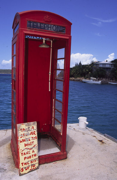 An island twist turns this traditional British red phone box into a yachty shower stall, Leverick Bay Marina, Virgin Gorda, British Virgin Islands, West Indies, Caribbean.