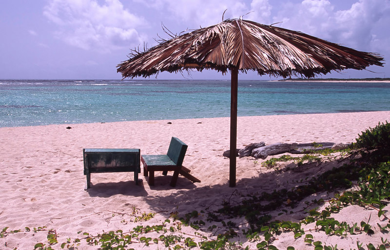 Thatched beach palapa at Loblolly Bay beach, North Shore, Anegada, British Virgin Islands (BVI), West Indies, Caribbean
